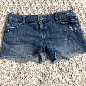 Jean shorts with paint splatters